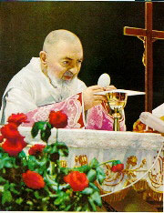 Padre Pio consecrating the Host
