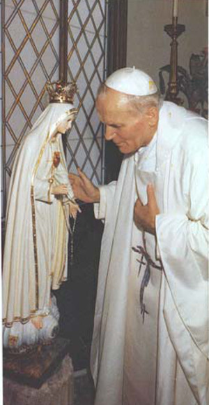 John Paul II with a statue of Our Lady of Fatima
