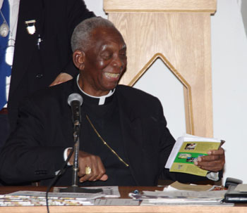 Cardinal Agre with Economic Democracy book